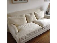 Four seater sofa beige feather filled zip cushions