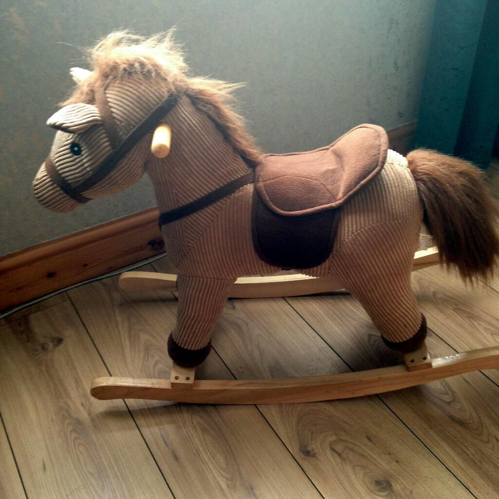 Brown & beige rocking horse on wooden runners as new