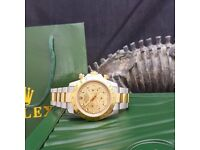 Champagne faced Rolex Daytona with gold Bezel, silver casing and a twotone oyster bracelet.