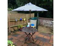 Wooden slatted garden table (no chairs) with wooden parasol
