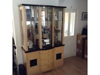 Tall standing wall unit with sideboard and nest of tables