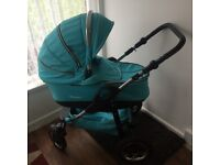 Quinny pram with removable carry cot.
