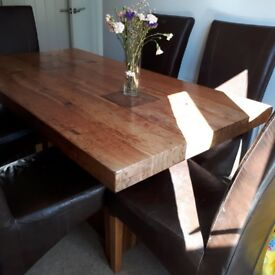 Solid oak table with 6 leather chairs & matching sideboarfd