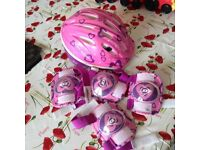 Child's bike helmet, knee pads & elbow pads