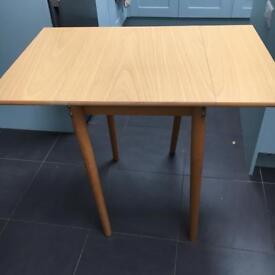 Light oak colour extendable small dining table