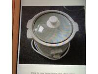 New, white Hinari slow cooker 1.5 pt capacity.