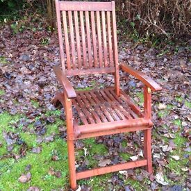 Wooden reclining garden chairs with cushions