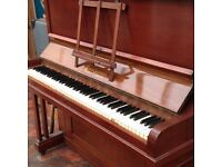 Upright piano. Overstrung. Needs attention