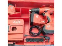 HILTI Cordless drill charger 3 .3 amp batteries in very good condition