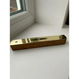 Old Wood & brass spirit level. Almost 6 inches long. Almost 1 inch wide. Depth 1 inch.