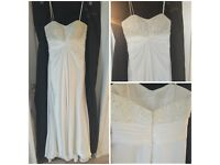 Wedding dress. Never been worn or altered. Quick sale!!
