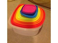 Set of 7 food storage boxes in graded sizes.