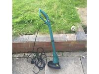 Electric grass trimmer with spool included