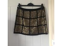Sequinned black and gold mini skirt size 10