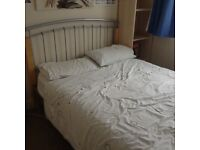 Metal framed bed and mattress