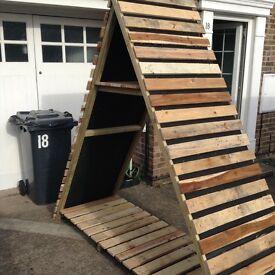 Hand made Triangular Log/wood Store/Shed