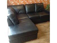 Black L shape leather grained sofa.