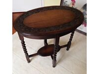 Carved dark oak small table