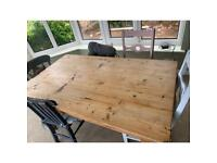Pine table and six random pine chairs