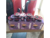Lavazza Amodo M10 coffee/cappacino machine with attached frother, 62 pods and instruction book.