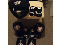 Full mma package boxing gloves, mma gloves, Wrist straps, head gear, knee and foot pads! NEW!