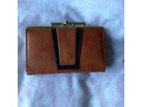 A Brand New and Retro Dark Tan and Brown Leather Purse.