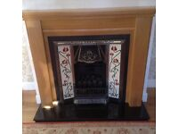 OAK FIREPLACE WITH CAST IRON TILED INSERT AND GAS FIRE