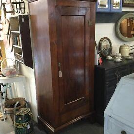 Unusual mahogany veneered Georgian Antique wardrobe. Lovely proportions.