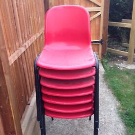 stacking red plastic chairs