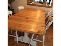Solid pine shabby chic dining table and four chairs for sale.