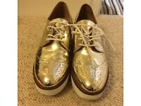 Shiny gold brogue flatforms - size 6 - nearly new