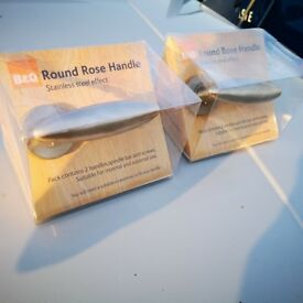 2 Sets of Round Rose door handles- 4 handles in total. all fittings included still in packaging.