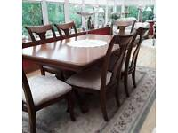 Reproduction dining table and eight chairs.