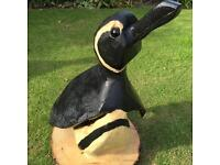 Chainsaw sculpture - penguin garden feature