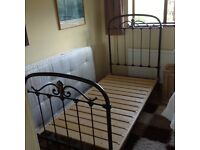 Single iron bedstead with mattress , which is hardly used.