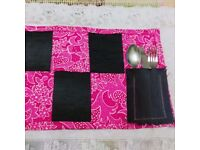 The set of four pink placemats