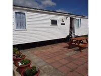 Very modern 6-8 berth Static Caravan. Double-glazed, central-heated, Fully equipped inc. patio