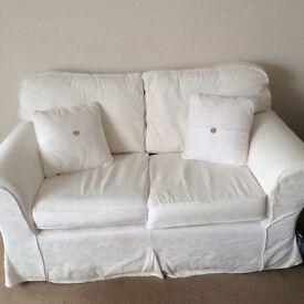 2 seater cream sofa