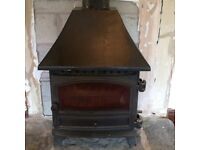 **£120** Log burner that is no longer required. 90cm by 60 cm. Flue also available. Collection only