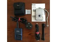 Canon digital IXUS 65 with accessories.....Charger, batteries, tripod, case, and instruction manual.