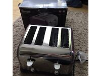 Swan plum four slice toaster, RRP £50. Still in box never used. Can deliver