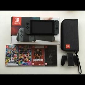 nintendo switch and three games | in Lisburn, County Antrim
