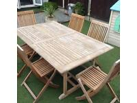 Solid wood garden extendable table and 6 chairs
