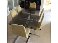 Glass Dining room table and chairs for sale