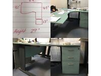 Green office desk and filing drawer