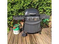 Gas-fired BBQ on wheels, with gas canister if required