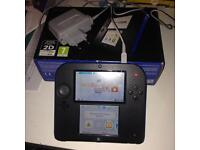 Nintendo 2DS with box and 2 games