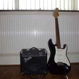 Squire stratocaster guitar with Fender training amp and guitar leads