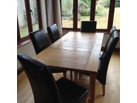 Oak dining table and six chairs. Extends from 140cms to 210cms. Good as new and barely used.