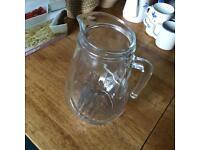 Large glass jug.